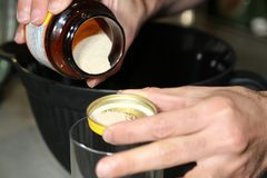 Pouring yeast grains to make bread stock photo