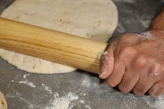 Making pizza dough! Pizza restaurant business front cover for magazine or books. The chef is ready to make a pizza! Picture is great to use for any topics in stock photos