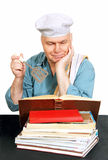Chef with recipe book. Royalty Free Stock Photos