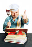 Chef with recipe book. Cook man looking for a recipe in the cook book, white background Royalty Free Stock Images