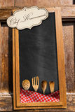 Chef Recommends - Blackboard with Kitchen Utensils Royalty Free Stock Images