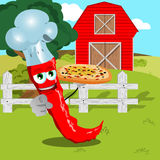 Chef red hot chili pepper with pizza pointing at viewer on a farm Royalty Free Stock Images