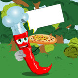 Chef red hot chili pepper with pizza pointing at viewer in the forest with speech bubble Royalty Free Stock Image