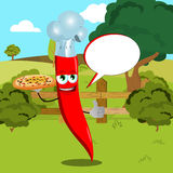 Chef red hot chili pepper with pizza showing thumb up on a meadow with speech bubble Stock Photos