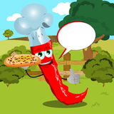 Chef red hot chili pepper with pizza showing thumb up on a meadow with speech bubble Royalty Free Stock Image
