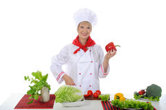 Chef with red pepper in her hand. Stock Images