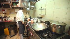 Chef in restaurant kitchen stock footage