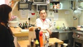 Chef in restaurant kitchen stock video