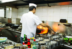 Chef in restaurant kitchen Royalty Free Stock Photography