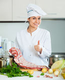 Chef with ribcage cooking at kitchen Royalty Free Stock Photo