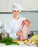 Chef with ribcage cooking at kitchen Royalty Free Stock Photos
