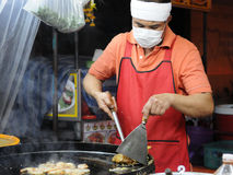 Chef at a Roadside Kitchen in Bangkok Royalty Free Stock Images