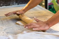 Chef rolling dough Royalty Free Stock Image