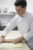 Chef Rolling Dough In Kitchen Stock Photos