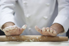 Chef Rolling Dough With Rollingpin Stock Photos