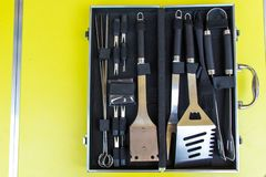Chef`s case full of tools for barbecue with black fabric inside stock image
