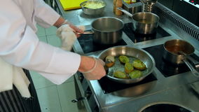 Chef`s hand making bread toasts on a frying pan stock video