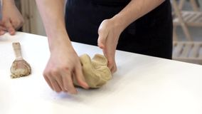 Chef`s hands prepare dough. Slow mo stock footage