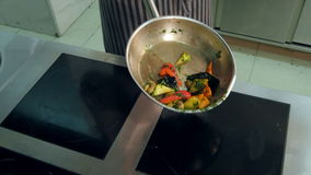 Chef`s hands tossing vegetables in wok pan stock video footage
