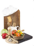 Chef's hat with battledore and cook book Royalty Free Stock Photos