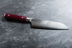 Chef`s knife from Damascus steel. A real Japanese work of art. View from above stock photography