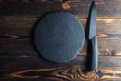 Chef`s knife on a wooden background space for copy royalty free stock photography