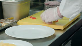 Chef`s male hands cutting tomatoes on a chopping board stock video footage