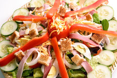 Chef's Salad. Close up view of a Chef's Salad artfully arranged on a gold-tone platter Stock Photos