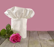 Chef's toque with pink rose Royalty Free Stock Photos