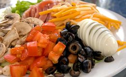 Chef Salad. Beautiful chef salad with tomatoes, sliced egg, cheese, olives, mushroom, turky & ham Stock Photo