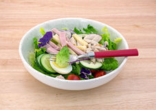 Chef salad with fork on wood table top Stock Image