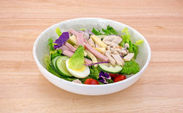 Chef salad on wood table Royalty Free Stock Photos