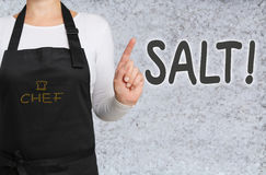 Chef with salt background concept template Royalty Free Stock Image