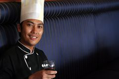 Chef Salute with red wine. Photograph of chef holding red wine royalty free stock images