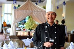 Chef salute at restaurant. Photograph of executive chef salute at restaurant with red wine. Chef series stock images