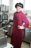 Chef with scoop. Professional chef cooking in commercial kitchen with scoop royalty free stock photography