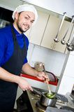 Chef with scoop Stock Image