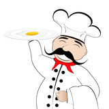 Chef with scrambled eggs on a plate Royalty Free Stock Photography