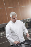 Chef Selecting Knife Out Of Full Set Royalty Free Stock Image