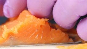 Chef separates salmon from the bones. Close up stock video