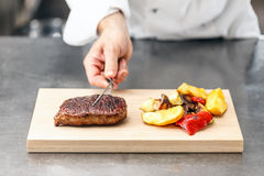 Chef served beef steak Stock Image