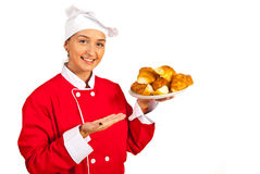 Chef serves croissants with pears Royalty Free Stock Photography