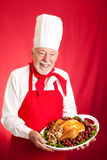 Chef Serves Holiday Dinner Royalty Free Stock Photos