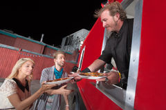 Serving Carryout Pizza from Food Truck. Chef serving carryout pizza from food truck Stock Photography