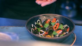 Cook is serving delicious mussels dish stock footage