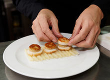Chef is serving foie gras with grilled scallops stock photo