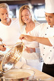 Chef serving food Royalty Free Stock Image