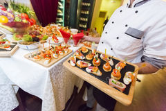 Chef serving food in restaurant Royalty Free Stock Photography