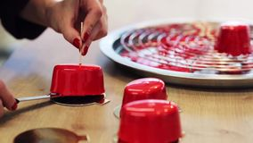 Chef serving mirror glaze cakes at pastry shop stock video footage