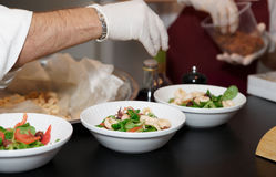 Chef is serving plates Royalty Free Stock Photo